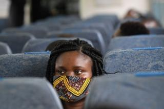 A passenger wears a face mask on board a Standard Gauge Railway (SGR) train.