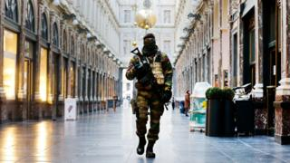 Belgian Army soldier walks through the Galleries Royal Saint-Hubert in the centre of Brussels.