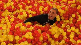 Man in adult ball pit