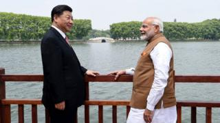 Prime Minister Narendra Modi (R) and Chinese President Xi Jinping looking on along the East Lake, in Wuhan.