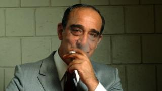 Carmine Persico, smiling and smoking