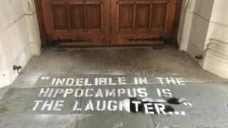 """Photo of graffiti on the floor that reads: """"Indelible in the hippocampus is the laughter"""""""