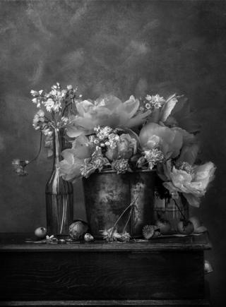 A photo of flowers in vases on a table