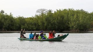 Gambians in a canoe row to Niafarang in Senegal - Tuesday 17 January 2017