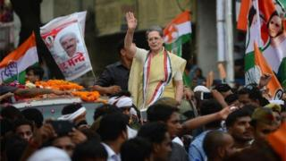 Indian Congress Party President Sonia Gandhi waves during a roadshow in Varanasi on August 2, 2016, ahead of 2017 Uttar Pradesh State Assembly elections