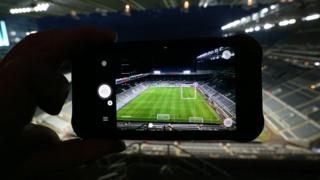 Photographing a football match