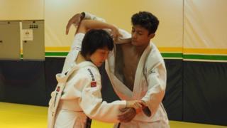 Yuko Fujii coaching a boy
