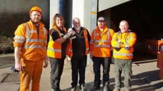 Workers at Bracknell Recycling Centre where they recovered £1,300 in lost cash