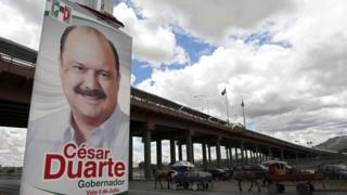 A poster with political propaganda of Chihuahua State Governor candidate, Cesar Duarte from the Institutional Revolutionary Party (PRI) on July 2, 2010, in Ciudad Juarez, Mexico.
