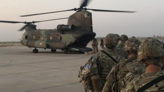 US troops walk towards a helicopter