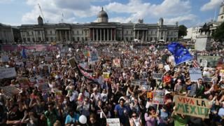 Thousands of protesters fill Trafalgar Square to protest against Donald Trump