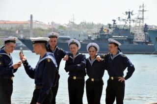 Russian sailors take selfies in the naval base at Sevastopol, Crimea