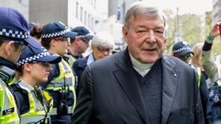 Cardinal George Pell outside the Melbourne Magistrates Court during a court hearing in 2017