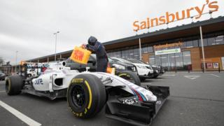 Williams F1 car in front of Sainsbury's