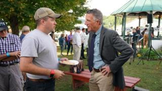 Phil Scott (R) talks to a voter at a Vermont fair
