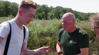 Joshua Styles (left) with a great sundew seedling