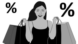 Black woman wey hold shopping bags.