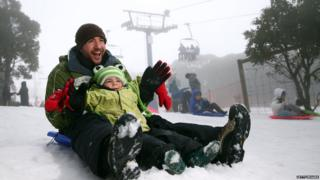 Craig and Cooper Hecht snow play on the toboggan during a cold snap on July 11, 2015 in Mount Buller, Australia.