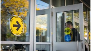 Voters make their way in and out of the polling station at the Mary McCormick Recreation Centre, in Toronto's Davenport riding, during the October 2015 general election