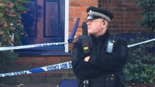 Police officer outside house