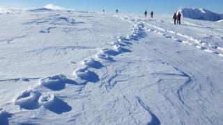 Raised footprints in snow in Lochaber