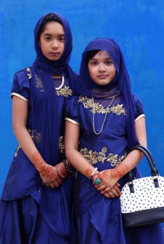 A pair of young girls in religious dress.
