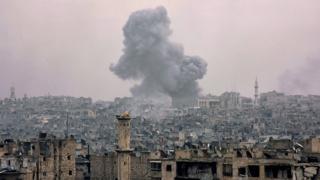 Smoke rising from buildings in Aleppo's eastern Karm al-Jabal neighbourhood