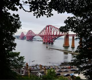A lucky gap in the trees offered this unusual view of the Forth Bridge during a cycle from Edinburgh to North Queensferry. Photo from the cycle path at South Queensferry looking north. Neil MacNeill, Edinburgh
