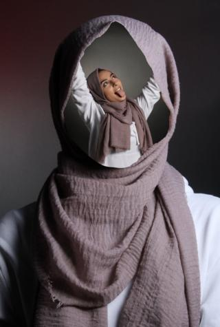 A hijab is used as a frame for a face