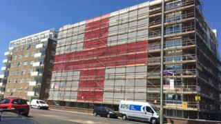 The building in Hove with the England flag erected