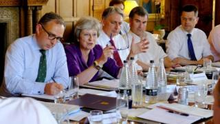 Prime Minister Theresa May speaks during the Cabinet ministers' meeting at Chequers,