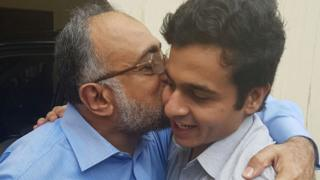 Awais Ali Shah pictured being hugged by his father