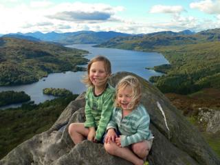 Jack (4) and Finn (2), at the summit of Ben A'an with the stunning backdrop of Loch Katrine in the background.