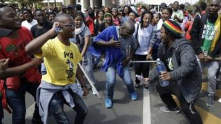 Students sing during their protest for free education in Johannesburg, South Africa, Tuesday, Sept. 20, 2016.
