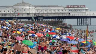 People enjoy the hot weather at Brighton beach, amid the coronavirus disease (COVID-19) outbreak, in Brighton, Britain, August 8, 2020