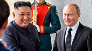Kim Jong-un and Vladimir Putin shaking hands