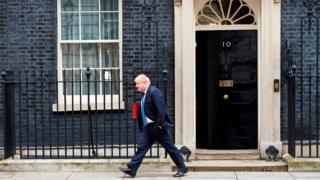 Boris Johnson leaving Downing street in 2018