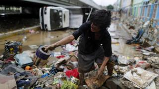 A Filipino resident search for salvageable materials