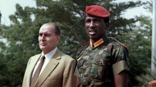 Ex-French President Francois Mitterrand and Captain Thomas Sankara at the Ouagadougou airport in 1986.