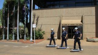 "Queensland police ride ""hoverboards"" in image released to the media"