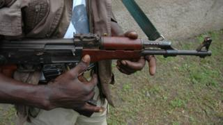 A man holds an AK-47 rifle (file image)