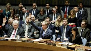 Ukraine ambassador Volodymyr Yelchenko (L) and UK ambassador Matthew Rycroft (2L) vote in favour of a draft resolution on Jerusalem at the UN Security Council on 18 December 2017