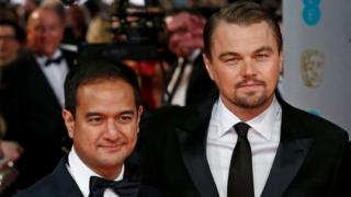 Riza Aziz, left, with Leonardo DiCaprio at the 2014 BAFTA Awards