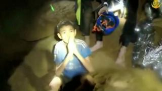 One of the boys trapped in a cave in Thailand greets rescuers