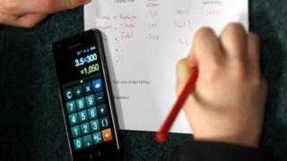 Pupil using phone as calculator