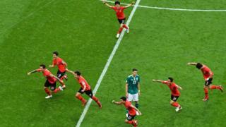 South Korea celebrate their first goal