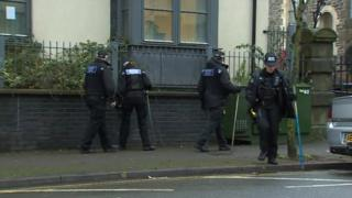 Police searching High Street, Swansea, following an incident on 23 December