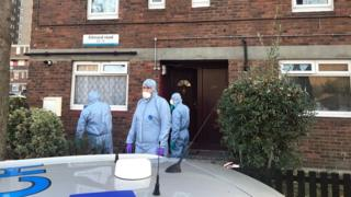 Forensic officers outside house in Ethnard Road, Peckham