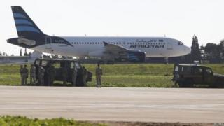 The Afriqiyah Airways plane was surrounded by Maltese troops on the runway