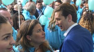 Sebastian Kurz talks to a party supporter in Vienna on 27 September